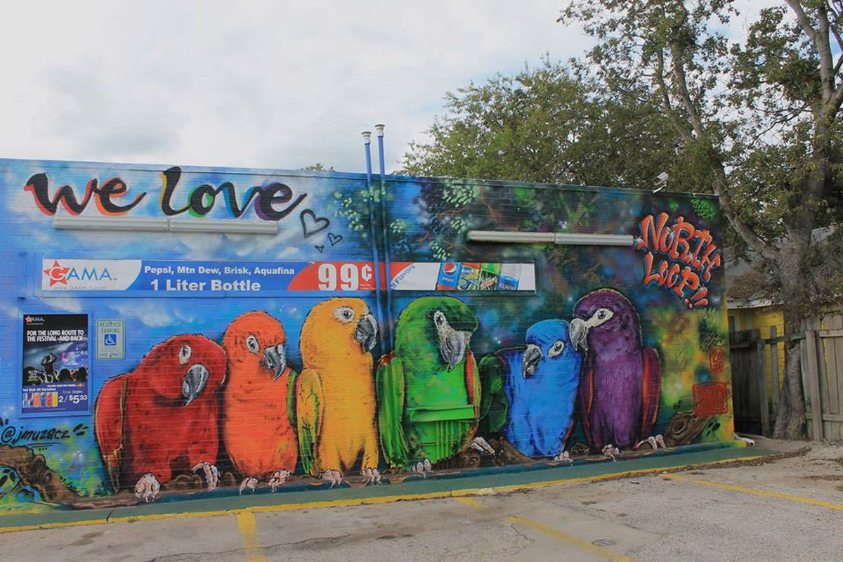 """A colorful mural of parrots that says """"We Love North Loop"""""""