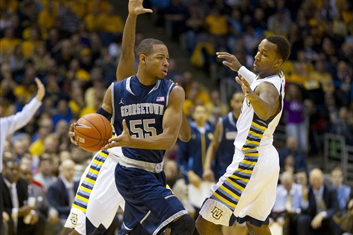 Mar 3, 2012; Milwaukee, WI, USA; Georgetown Hoyas guard Jabril Trawick (55) looks to pass the ball around Marquette Golden Eagles guard Todd Mayo (4) during the first half at the Bradley Center.  Mandatory Credit: Jeff Hanisch-US PRESSWIRE