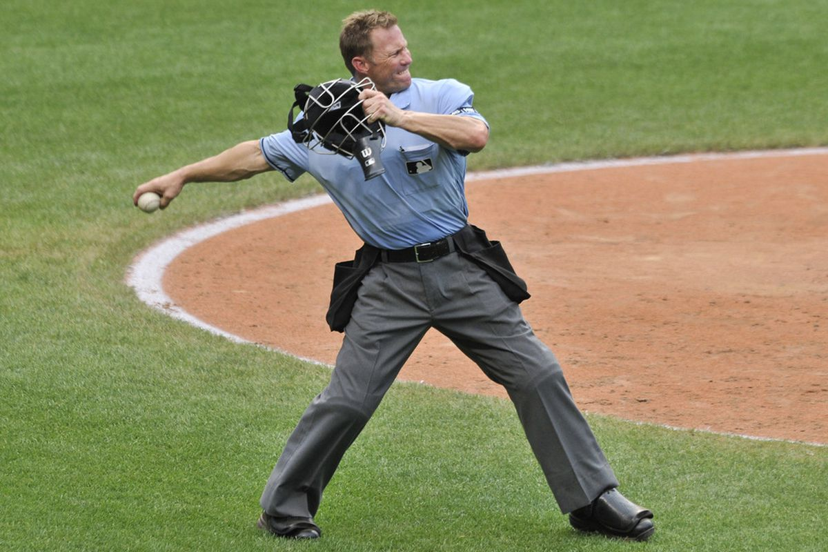 MLB umpire Jim Wolf warms up before coming in to pitch the 8th inning for the Angels.