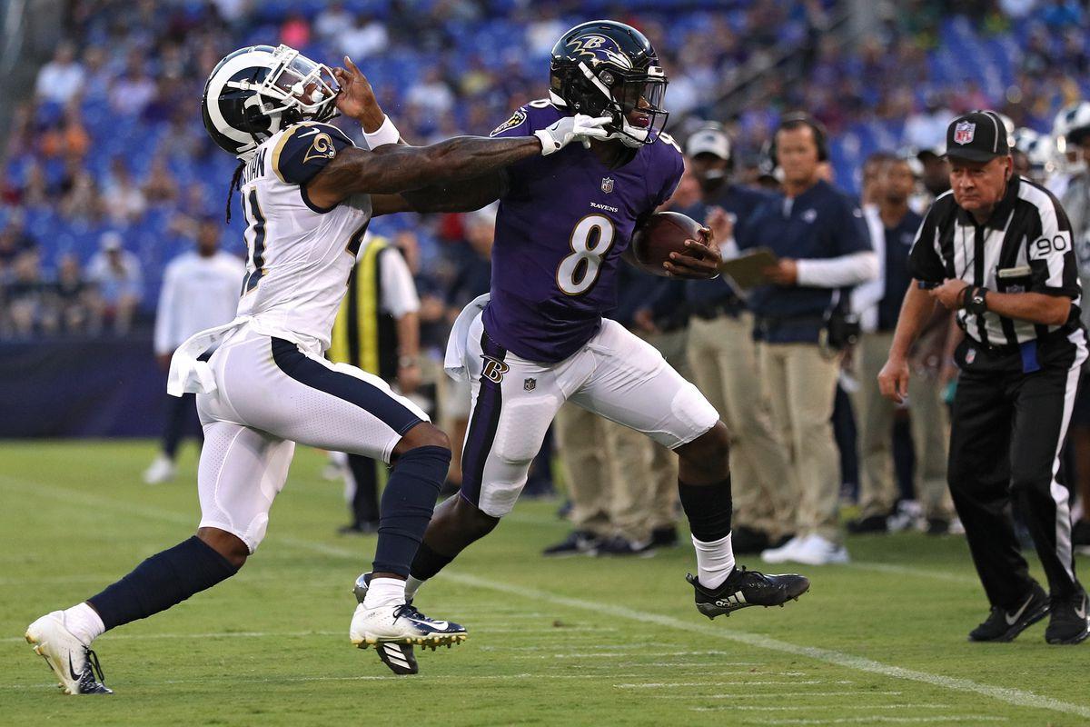 Baltimore Ravens QB Lamar Jackson stiff arms Los Angeles Rams S Marqui Christian, August 9, 2018.