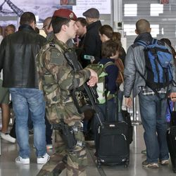 A French soldier patrols at Charles de Gaulle airport, in Roissy, north of Paris, Tuesday, March 22, 2016. Authorities are tightening security at airports and on the streets of European cities after attacks on the Brussels airport and subways system that killed at least 34 people and injured many others. Security has been beefed up in France, Austria, Poland and the Czech Republic.
