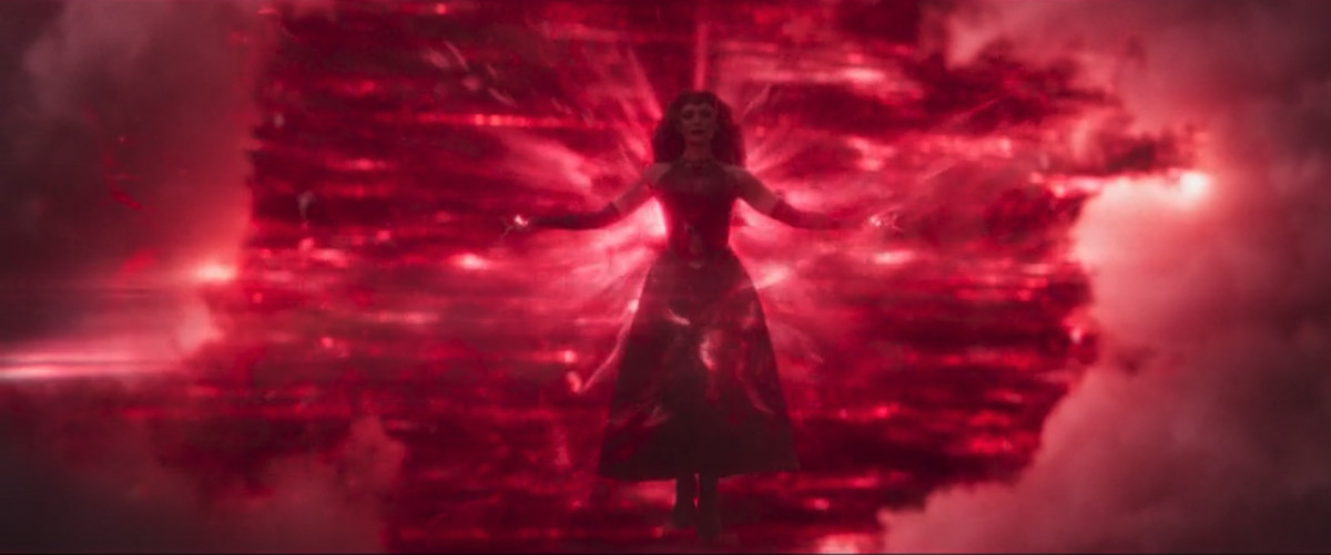 Wanda's new Scarlet Witch costume, complete with gloves, skirt/leggings combo, and a red, two-pronged crown in WandaVision.