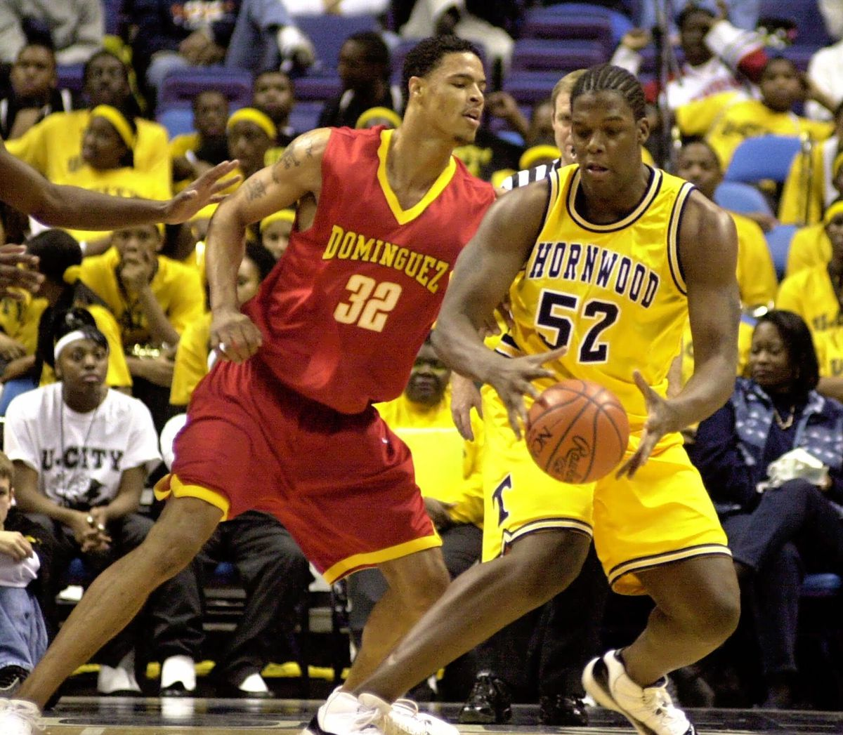 Thornwood's Eddy Curry (52) sets to make a move against Dominguez High School's Tyson Chandler (32) during the first half of the High School Shootout at the Savvis Center in St. Louis Thursday, Dec. 7, 2000.