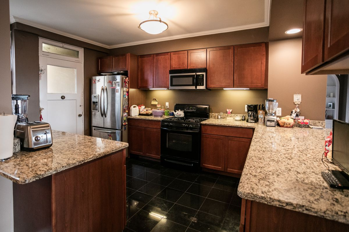 Kitchen with granite countertops and cherry cabinets