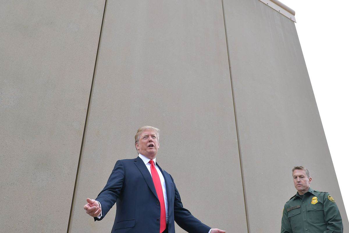 President Donald Trump speaks in front of a border wall prototype.