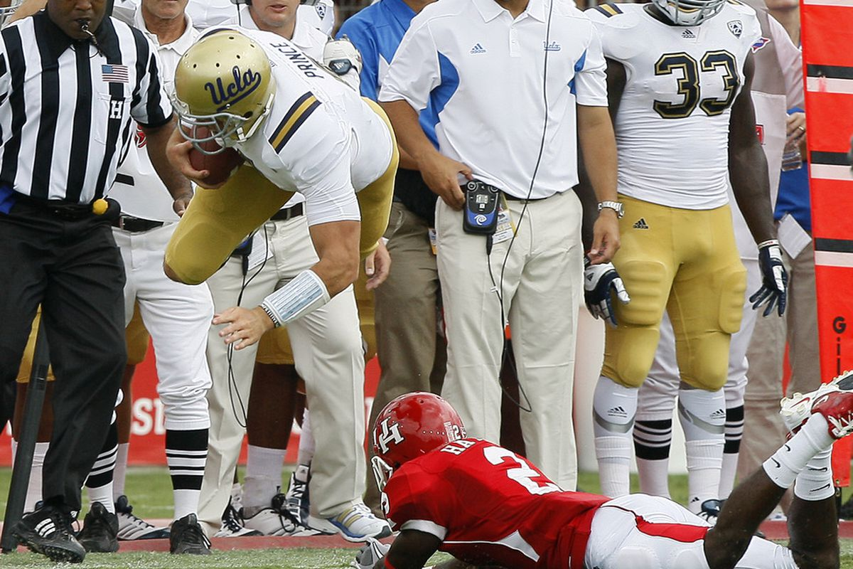 UCLA played 30 road games the last 5 years. If it had played 21, like Arkansas, Neuheisel might still have a job. — Chris Huston (@Heismanpundit)  (Photo by Bob Levey/Getty Images)