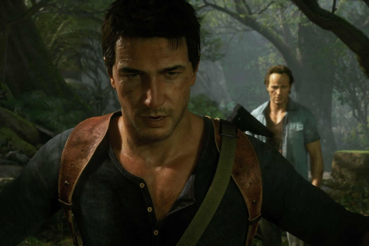 nathan drake stands in a jungle with his back to his brother sam drake in uncharted 4
