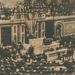 "U.S. President Woodrow Wilson addresses Congress and asks that body to declare war and ""make the world safe for democracy."" Four days later on April 6, 1917, war was declared."
