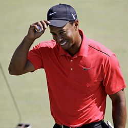 Tiger Woods tips his cap after putting out on the 18th green during the fourth round of the Masters golf tournament Sunday, April 8, 2012, in Augusta, Ga. (AP Photo/Chris O'Meara)