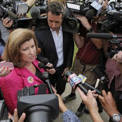 Karen Handel, Republican candidate for Congress, talks to the press Tuesday, June 20, 2017, after she voted in the 6th District Special Election at St Mary's Orthodox Church in Roswell, Ga. The matchup of Republican Handell and Democrat Jon Ossoff has become a proxy for the national political atmosphere and a test of GOP strength early in Donald Trump's presidency.