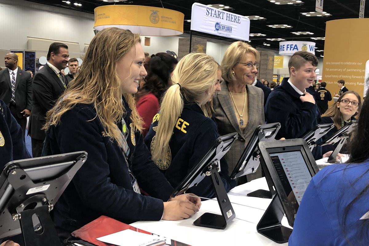 Betsy DeVos, U.S. secretary of education, tours exhibits at the annual FFA national convention in Indianapolis.