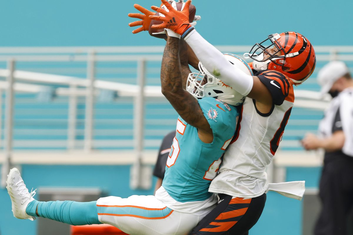 Cornerback Xavien Howard #25 of the Miami Dolphins intercepts a pass meant for wide receiver Tyler Boyd #83 of the Cincinnati Bengals in the first quarter of the game at Hard Rock Stadium on December 06, 2020 in Miami Gardens, Florida.