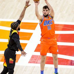 Oklahoma City Thunder guard Ty Jerome (16) shoots over Utah Jazz guard Mike Conley (10) during the game at Vivint Smart Home Arena in Salt Lake City on Tuesday, April 13, 2021.