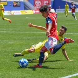 Kevin Bonilla (12) attempting a cross during the opening match of the 40th Annual Dallas Cup.