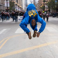 A member of the Chicago Boyz Acrobatic Team performs a flip during the 85th Annual Thanksgiving Day Parade on November 22, 2018   Max Herman/For the Sun-Times
