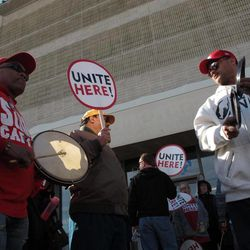 Tropicana employees Julio Laranque, left, and Rudy Castillo, right, bang on percussion instruments at a protest on the Atlantic City N.J. Boardwalk against the Tropicana Casino and Resort on April 5, 2012. The union is fighting the casino's attempt to terminate a pension plan for workers in favor of direct cash payments to them.