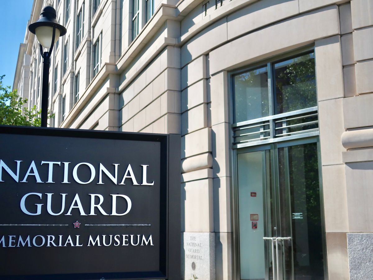 The entrance to the National Guard Memorial Museum, with a sign advertising the museum outside the building.