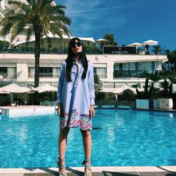 Wearing Tommy Hilfiger by the pool at the Martinez.