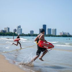 Kids take part in a junior lifeguard relay at Montrose Beach on July 24, 2019.