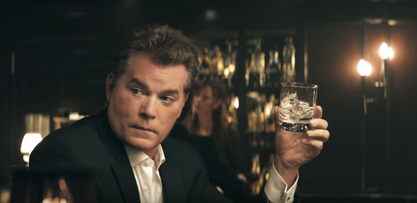 Ray Liotta staring back toward the other man in the bar