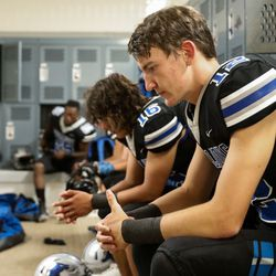 Stansbury's Matthew Topham looks down as he prepares for a high school football game against Tooeleat Stansbury High School in Stansbury Park on Friday, Sept. 17, 2021.