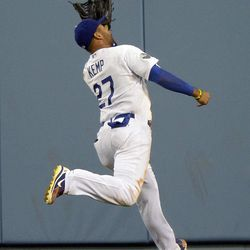 Los Angeles Dodgers center fielder Matt Kemp makes a catch over his head on a ball hit by St. Louis Cardinals' Daniel Descalso during the eighth inning of their baseball game, Thursday, Sept. 13, 2012, in Los Angeles.