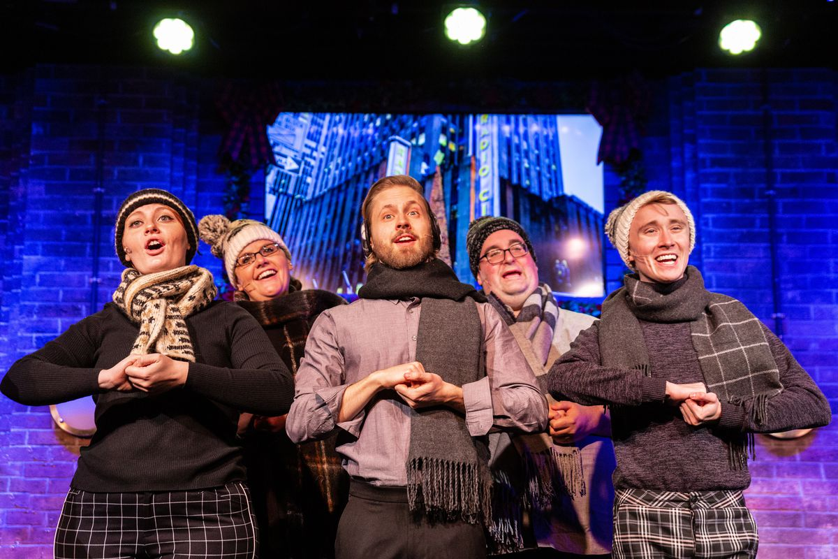 "Shelby Plummer (front row, from left), Henrik Blix, George Elrod, and (back row) Jess DeBacco and Rob Grabowski in ""Deck the Hallmark: A Greeting Card Channel Original"" at Second City."