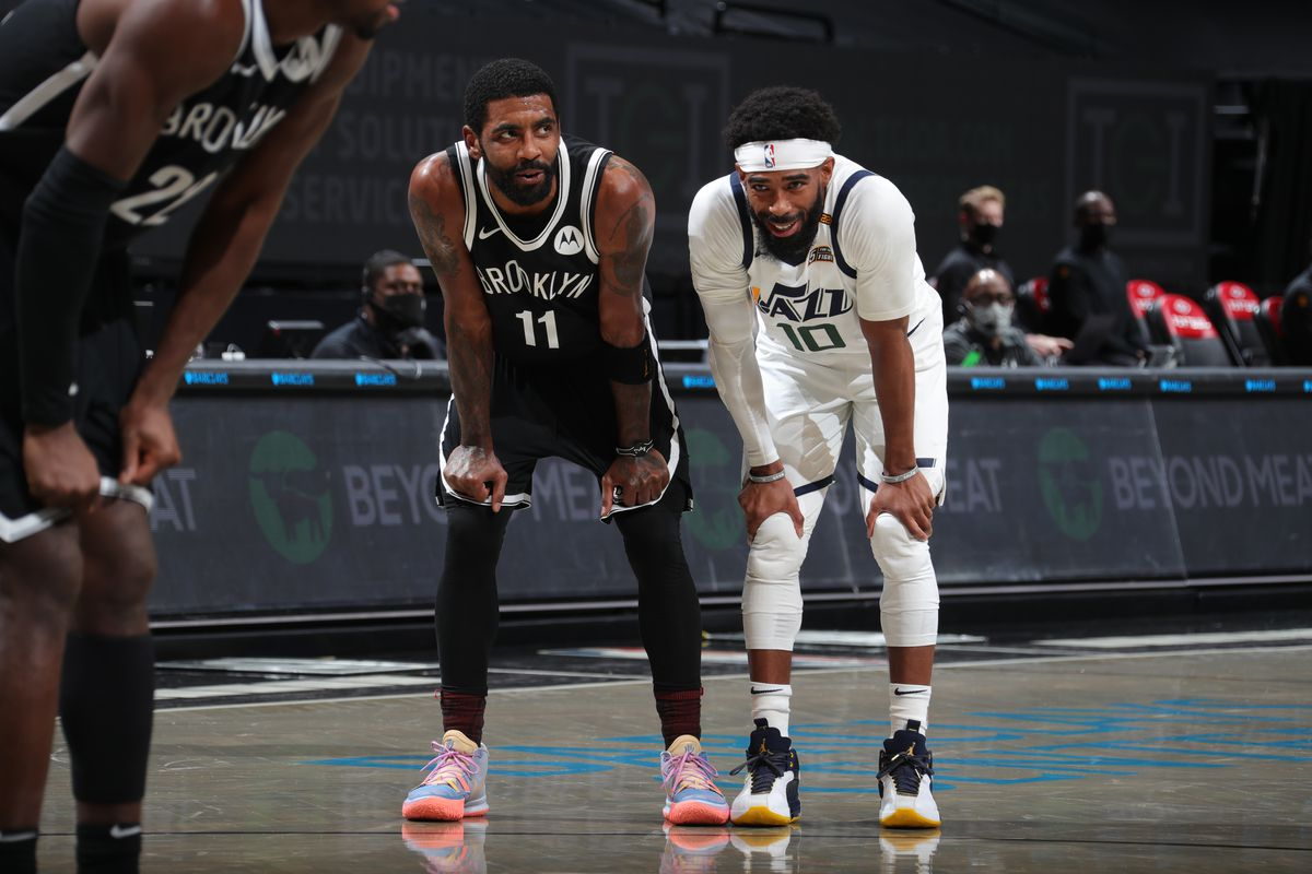 Kyrie Irving of the Brooklyn Nets and Mike Conley of the Utah Jazz looks on during the game on January 5, 2021 at Barclays Center in Brooklyn, New York.