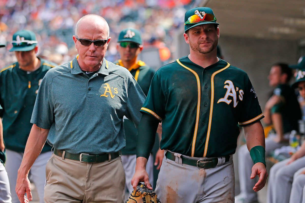 Stephen Vogt walks to the clubhouse after exiting the ninth inning of Thursday's game against the Detroit Tigers with a leg cramp.