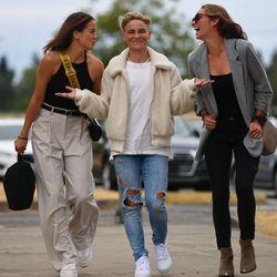 Jess Fishlock flanked by Lauren Barnes and Dani Weatherholt.