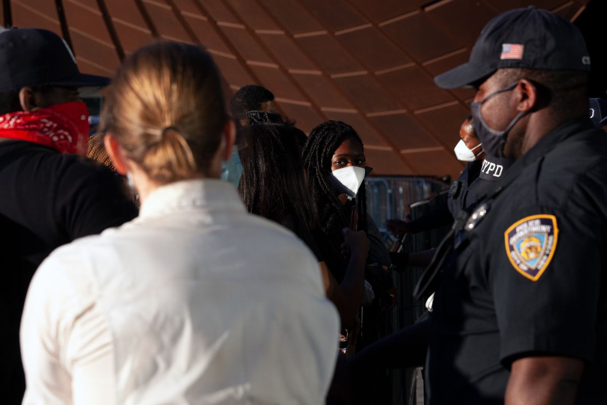 Protesters engage in a dialogue with NYPD officers outside the Barclays Center, May 31, 2020.