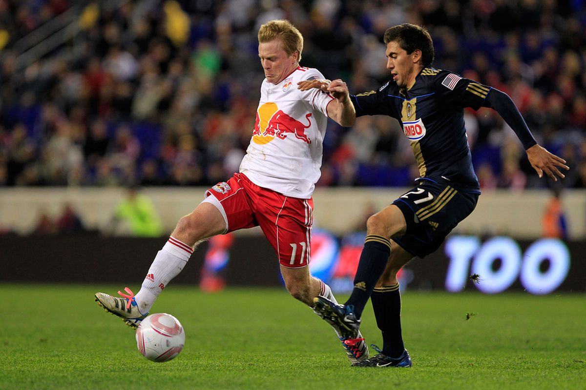 HARRISON, NJ - OCTOBER 20: Dax McCarty of the New York Red Bulls is challenged by Michael Farfan #21 of the Philadelphia Union at Red Bull Arena on October 20, 2011 in Harrison, New Jersey.  (Photo by Chris Trotman/Getty Images)