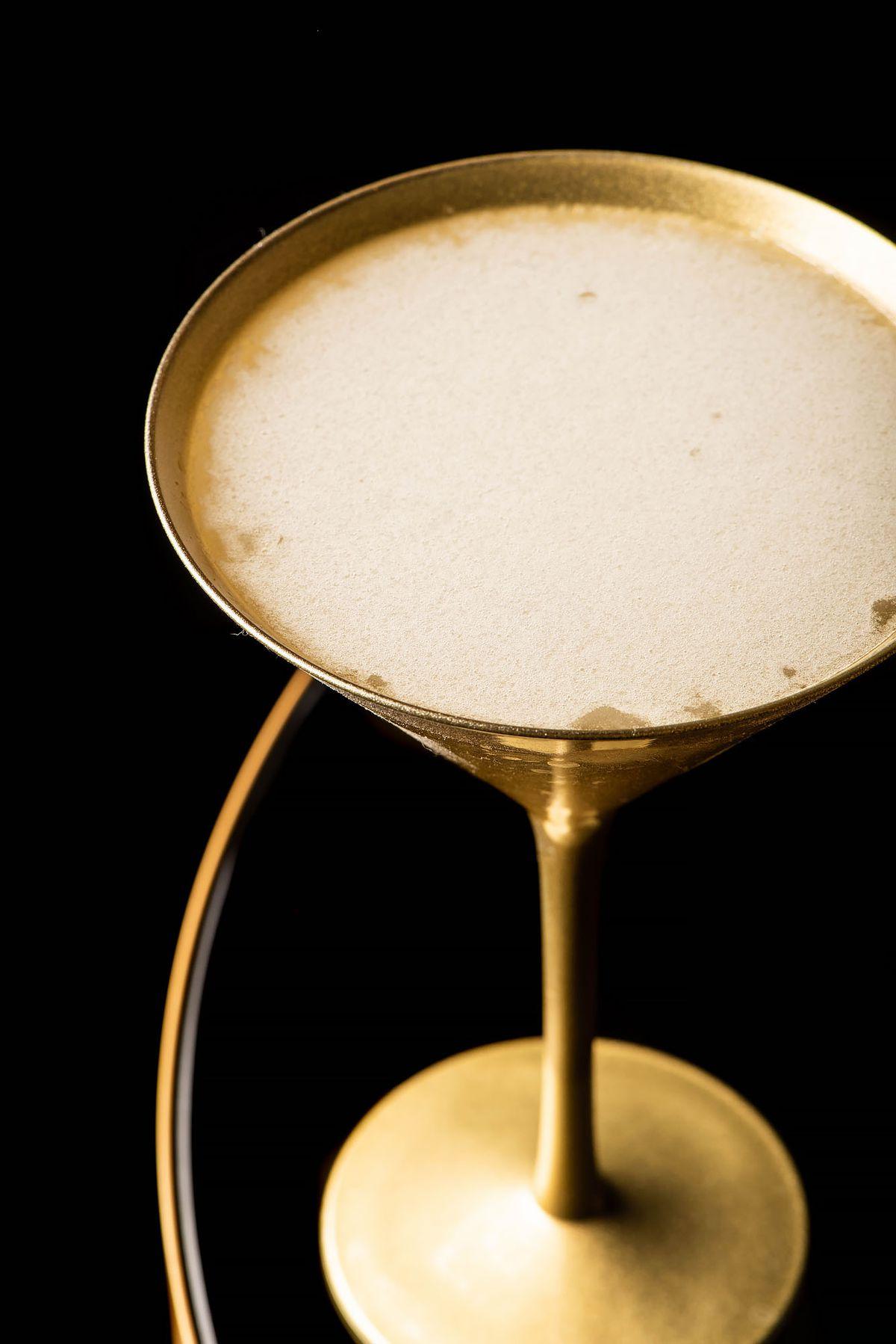 Cadillac margarita in a gold martini glass