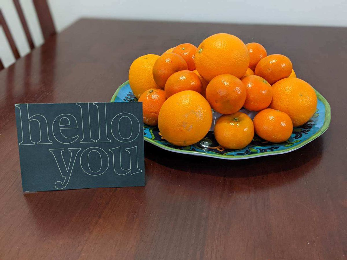 A plate of oranges with a welcome sign await a new refugee family in an apartment furnished by a group of Latter-day Saint volunteers in Houston.