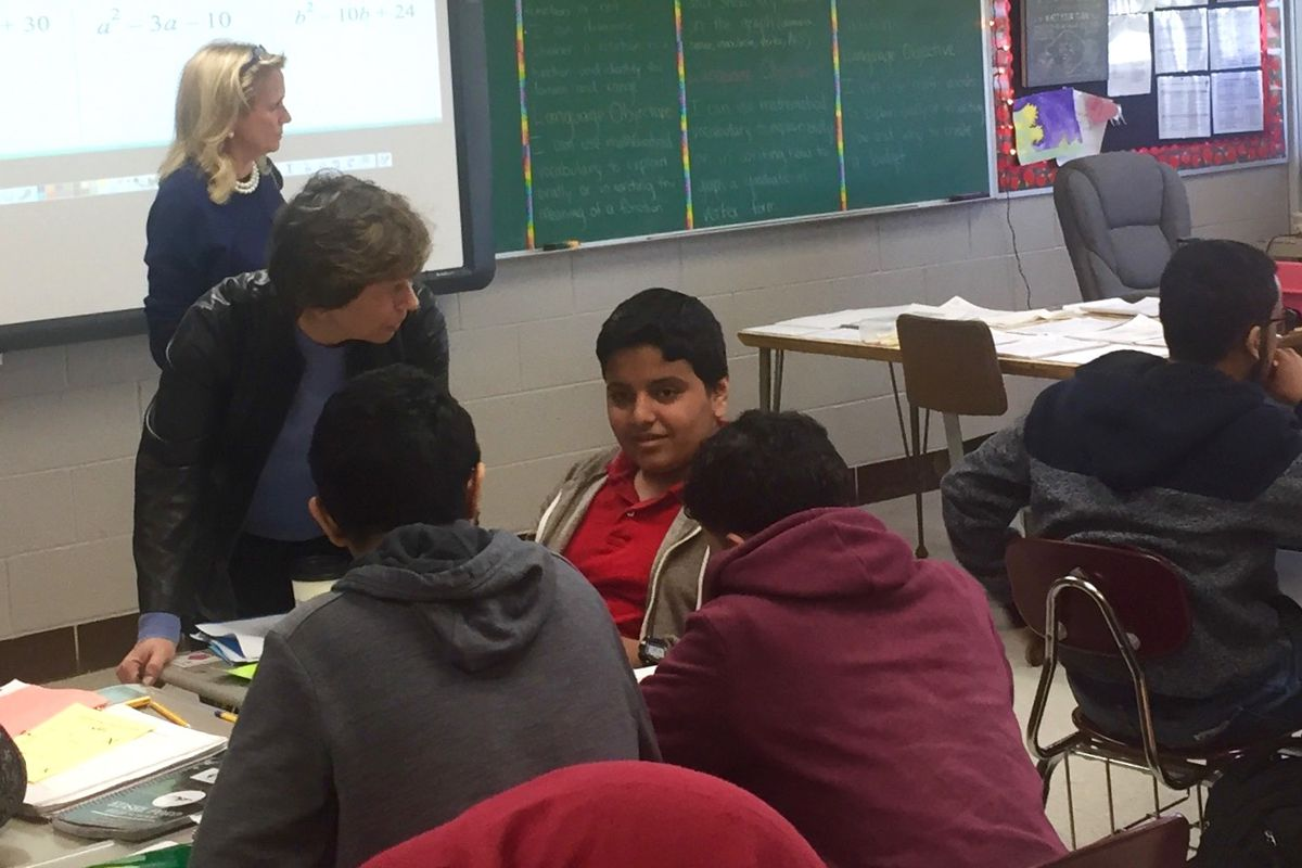 American Federation of Teachers President Randi Weingarten talks to students in a math class for English language learners at Edsel Ford High School in Dearborn, Michigan.