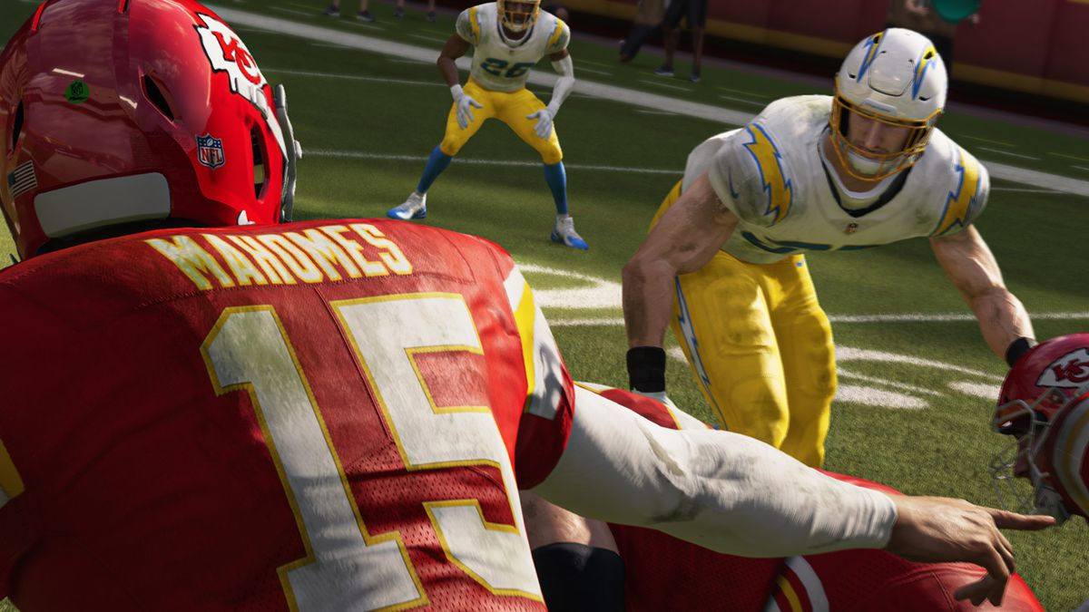 a close-up from behind Kansas City Chiefs quarterback Patrick Mahomes, looking toward a Los Angeles Chargers defender at the line of scrimmage in Madden NFL 21