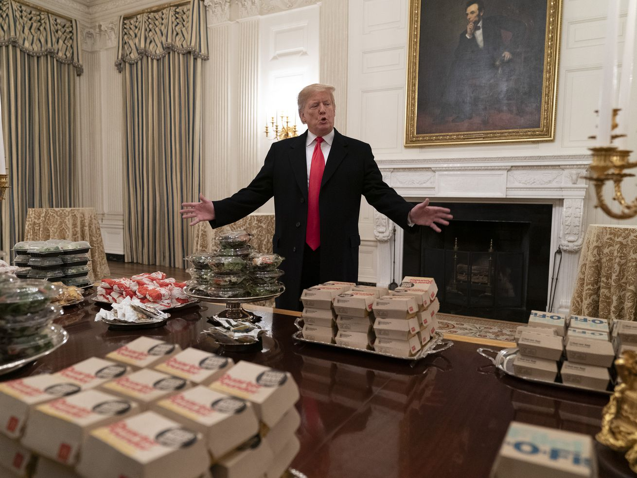 Trump presenting a buffet of fast food to be served to the Clemson Tigers football team.
