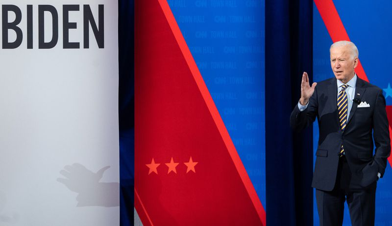 President Joe Biden stands on a stage in Milwaukee, Wisconsin
