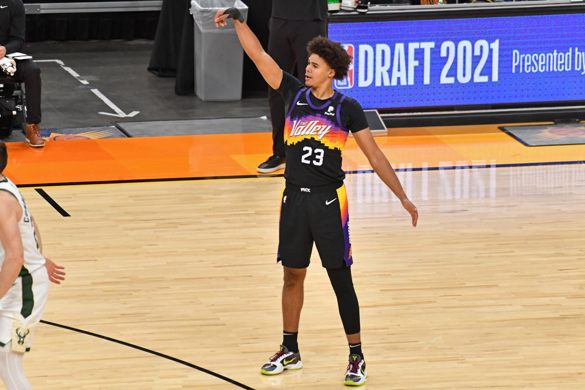 Cameron Johnson of the Phoenix Suns celebrates a three point basket against the Milwaukee Bucks during Game One of the 2021 NBA Finals on July 6, 2021 at Phoenix Suns Arena in Phoenix, Arizona.