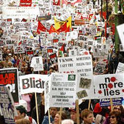 Anti-war protesters, about 20,000 strong, march through the streets of London.