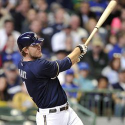 Milwaukee Brewers' Corey Hart watches his solo home run against the St. Louis Cardinals during the fifth inning of a baseball game, Sunday, April 8, 2012, in Milwaukee.