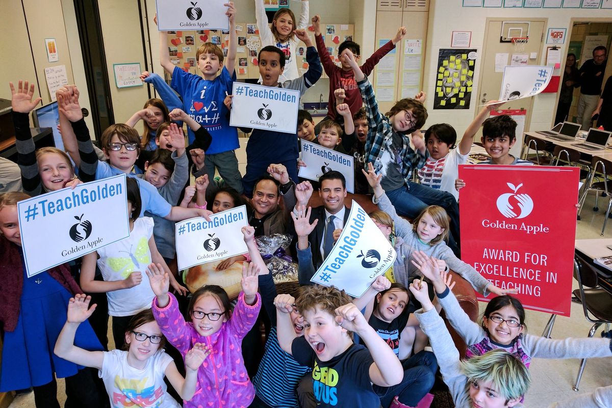 Fitzgerald Crame celebrates his 2017 Golden Apple Award with his students