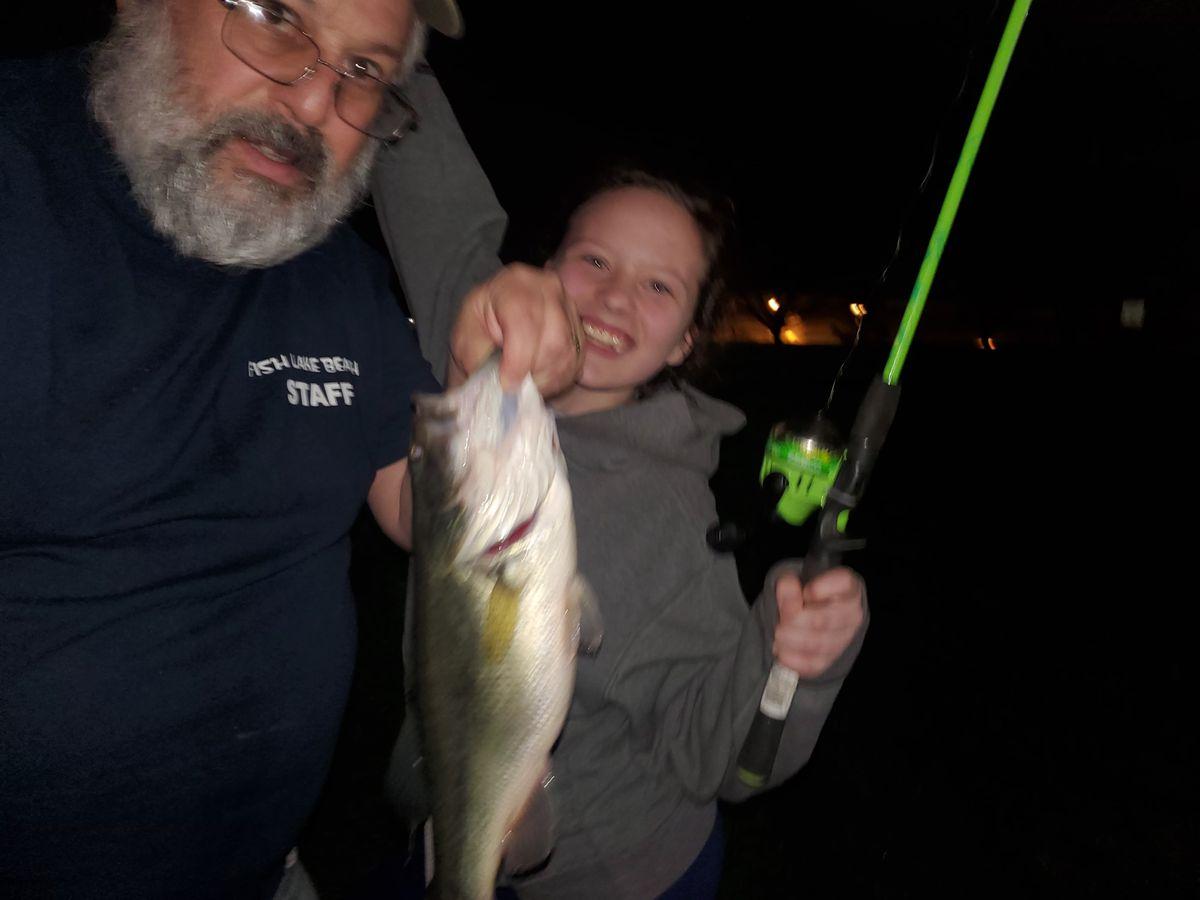 Bob France and granddaughter Abbie Rickelman with a post-rain bass. Provided photo