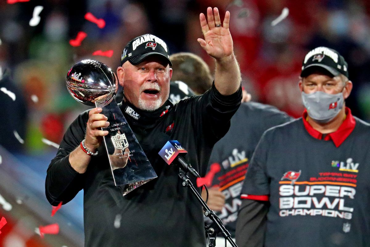 Tampa Bay Buccaneers head coach Bruce Arians celebrates with the Vince Lombardi Trophy after the Tampa Bay Buccaneers beat the Kansas City Chiefs in Super Bowl LV at Raymond James Stadium.