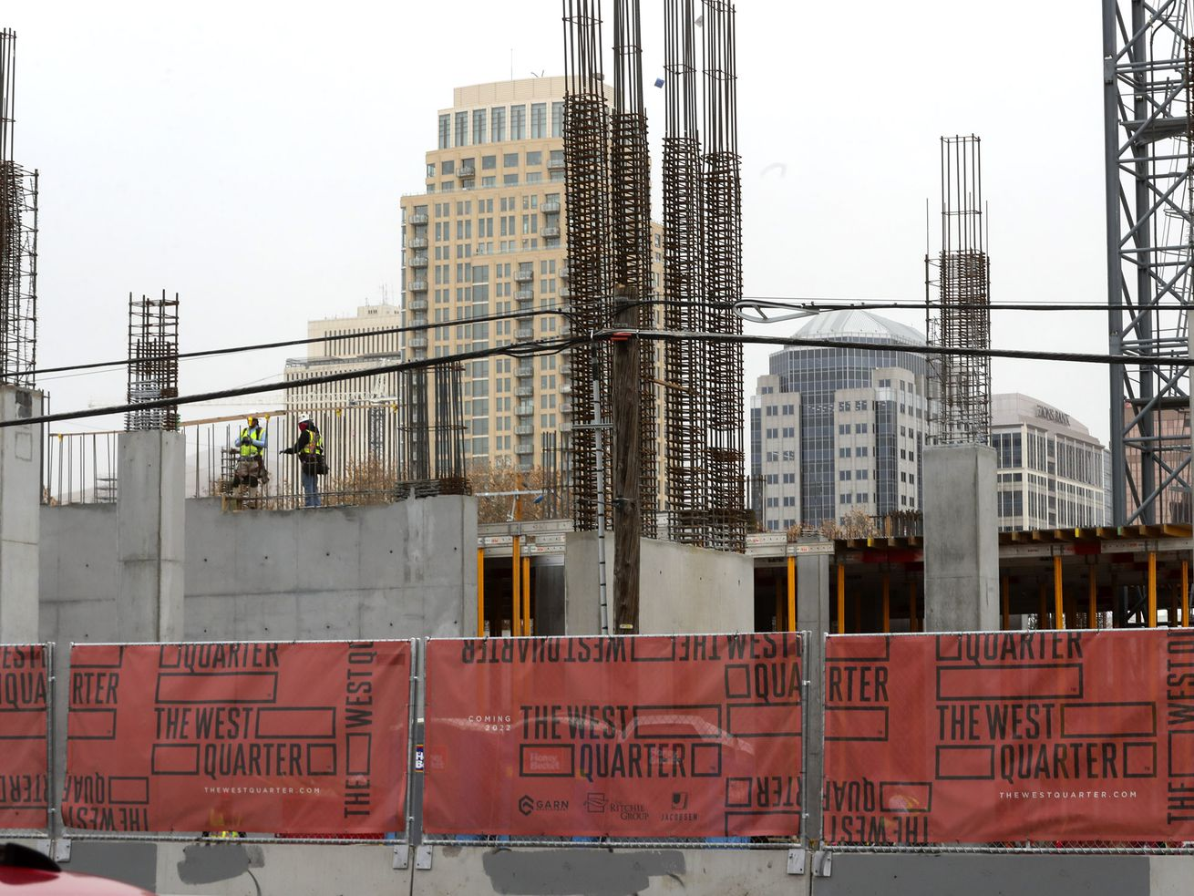The Salt Lake City skyline rises above construction on the West Quarter, a multiuse development that will feature resident living, retail space and a hotel on Wednesday, Nov. 18, 2020. The development is located at 100 South and 300 West.