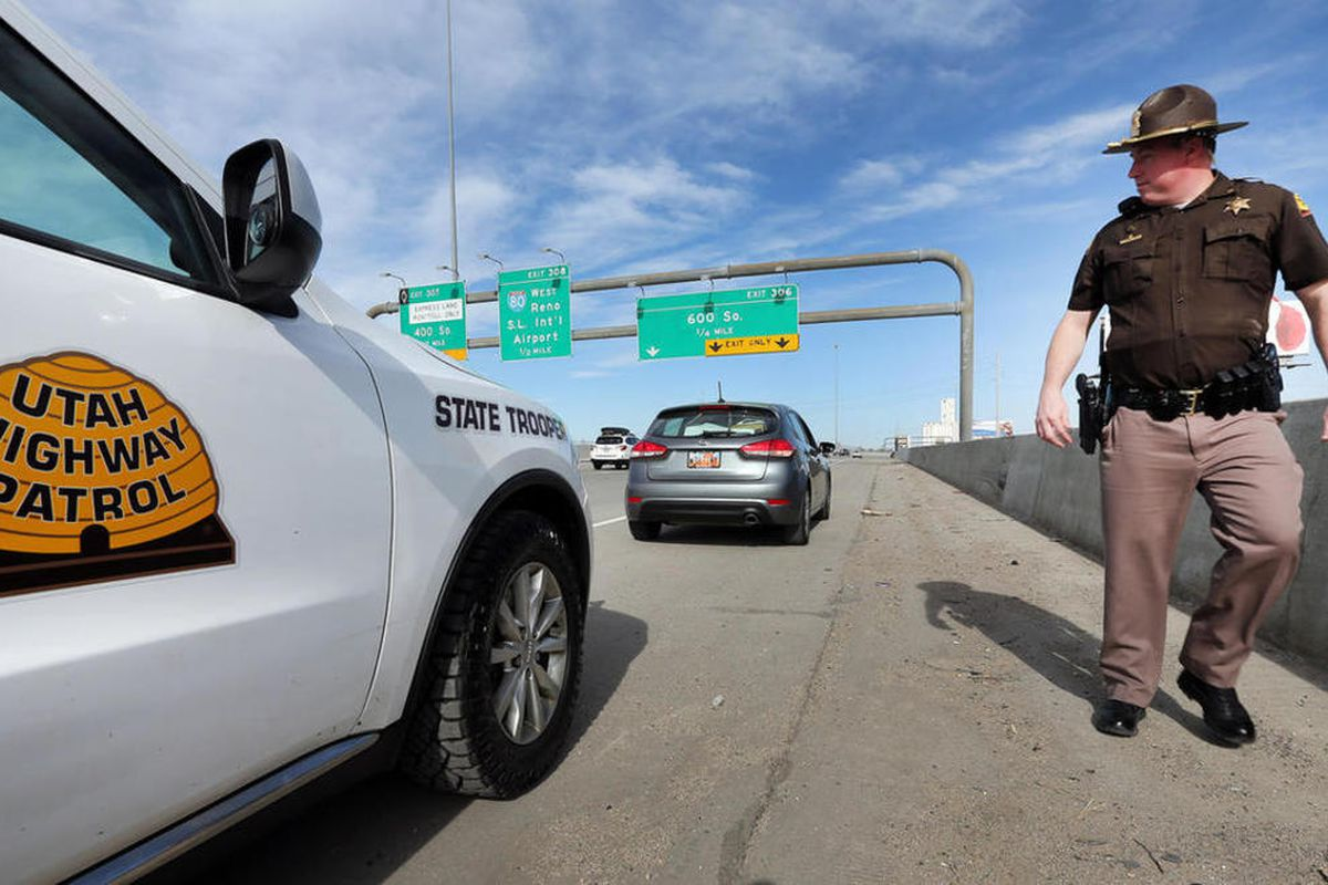 """FILE""""""""Trooper Nick Swallow walks back to his vehicle during a traffic stop along I-15 in Salt Lake City. Law enforcement agencies gather at Sugarhouse Park for a press conference on Thursday, March 16, 2017, to remind people not to drink and drive."""