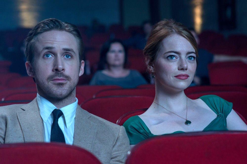 Ryan Gosling and Emma Stone sit in a movie theater in La La Land