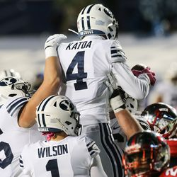 Brigham Young Cougars players celebrate after Brigham Young Cougars running back Lopini Katoa (4) scored a touchdown during an NCAA football game at LaVell Edwards Stadium in Provo on Saturday, Oct. 31, 2020.