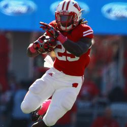 Running Back Melvin Gordon finds a hole in the first half against Illinois