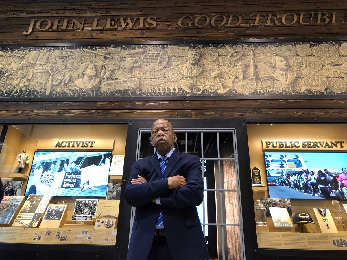 john lewis crosses his arms